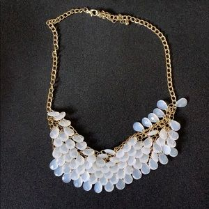 Gold and white necklace